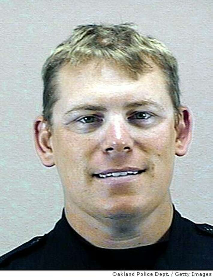 OAKLAND, CA - UNDATED:  In this handout image provided by the Oakland Police Department ,Oakland Police Sgt. Mark Dunakin is seen in this undated image in Oakland, California.  Sgt. Dunakin was one of Three Oakland police officers to be killed during a traffic stop and standoff with a gunman while another officer remains in critical condition. The suspect was also shot and killed by police.  (Photo by Oakland Police Department via Getty Images) Photo: Oakland Police Dept., Getty Images