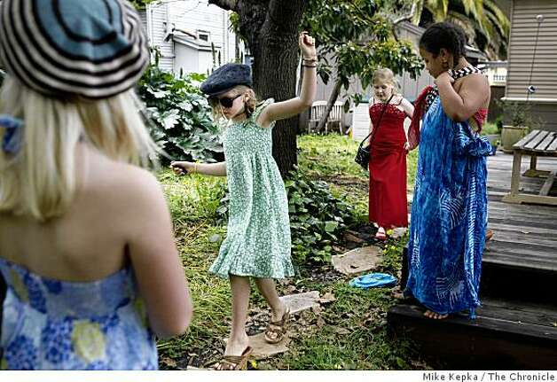 Lydia Macy, 8, Rachel Aronson, 8, Caroline Hall, 8, and Kiki Valenzuela, 8, all second graders at Malcolm X Elementary School play a dress-up game in the Macy's backyard on Tuesday April 28, 2009 in Berkeley, Calif. Photo: Mike Kepka, The Chronicle