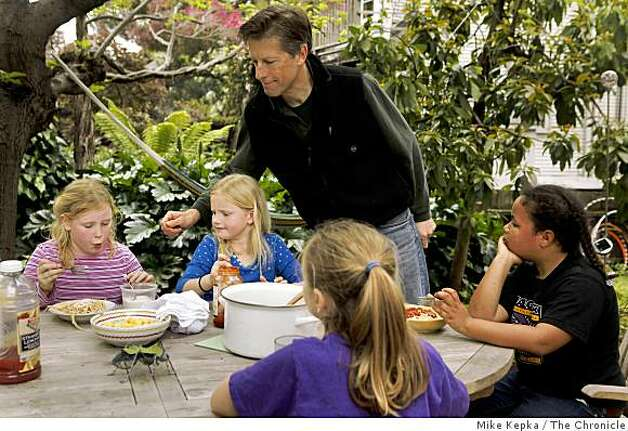 Jack Macy serves a spaghetti lunch in his back yard to eight-year-olds Caroline Hall (from left), Lydia Macy (his daughter), Rachel Aronson, and Kiki Valenzuela all second graders at Malcolm X Elementary on Tuesday April 28, 2009 in Berkeley, Calif. Photo: Mike Kepka, The Chronicle