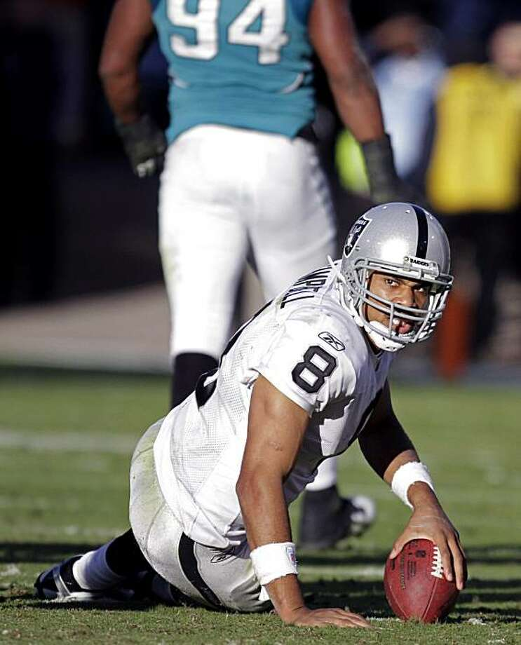 Oakland Raiders quarterback Jason Campbell (8) gets up after being sacked by Jacksonville Jaguars defensive end Jeremy Mincey (94) with 18 seconds left in an NFL football game, Sunday, Dec. 12, 2010, in Jacksonville, Fla. Jacksonville won 38-31. Photo: John Raoux, AP