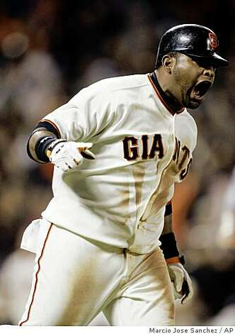 San Francisco Giants' Pablo Sandoval celebrates as he rounds first base after his walk off three-run home run off Washington Nationals relief pitcher Joe Beimel in the ninth inning of a baseball game in San Francisco, Tuesday, May 12, 2009. (AP Photo/Marcio Jose Sanchez) Photo: Marcio Jose Sanchez, AP