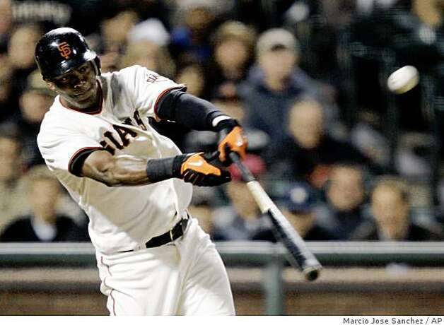 San Francisco Giants' Edgar Renteria drives in two runs with a single off Washington Nationals starting pitcher Jordan Zimmermann in the fourth inning of a baseball game in San Francisco, Tuesday, May 12, 2009. (AP Photo/Marcio Jose Sanchez) Photo: Marcio Jose Sanchez, AP