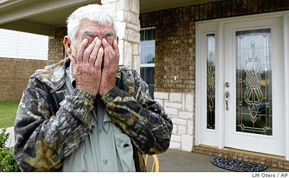 Wilburn C. Russell, 73, wipes his eyes after talking to reporters in front of the  house his son U.S. Army Sgt. John Russell purchased in Sherman, Texas, Tuesday, May 12, 2009.  Russell's son is accused of killing five fellow troops at their base  in Iraq.   (AP Photo/LM Otero) Photo: LM Otero, AP