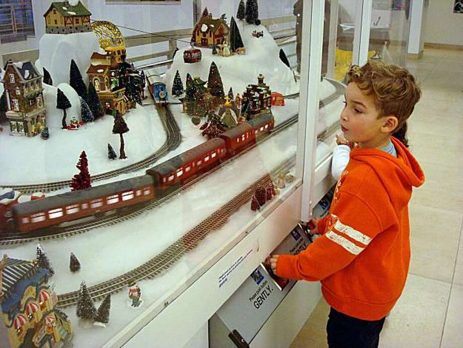 Children check out the Holiday Trains at the S.F. Main Library. Photo: Mary Ellen Hunt