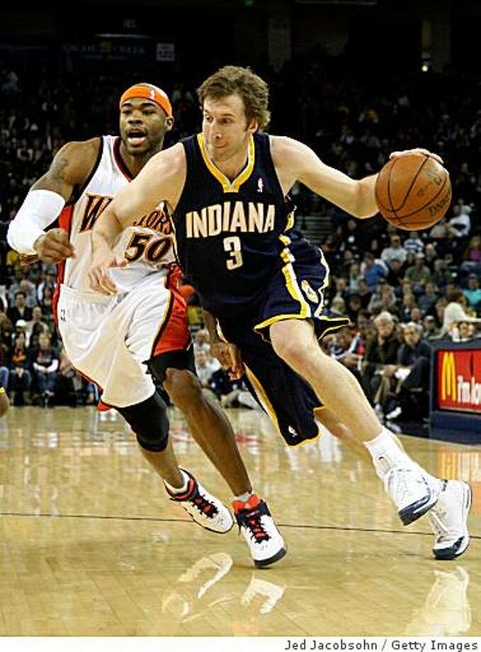 OAKLAND, CA - JANUARY 11: Troy Murphy #3 of the Indiana Pacers drives against Corey Maggette #50 of the Golden State Warriors during an NBA game on January 11, 2009 at Oracle Arena in Oakland, California. NOTE TO USER: User expressly acknowledges and agrees that, by downloading and or using this photograph, User is consenting to the terms and conditions of the Getty Images License Agreement. (Photo by Jed Jacobsohn/Getty Images) Photo: Jed Jacobsohn, Getty Images
