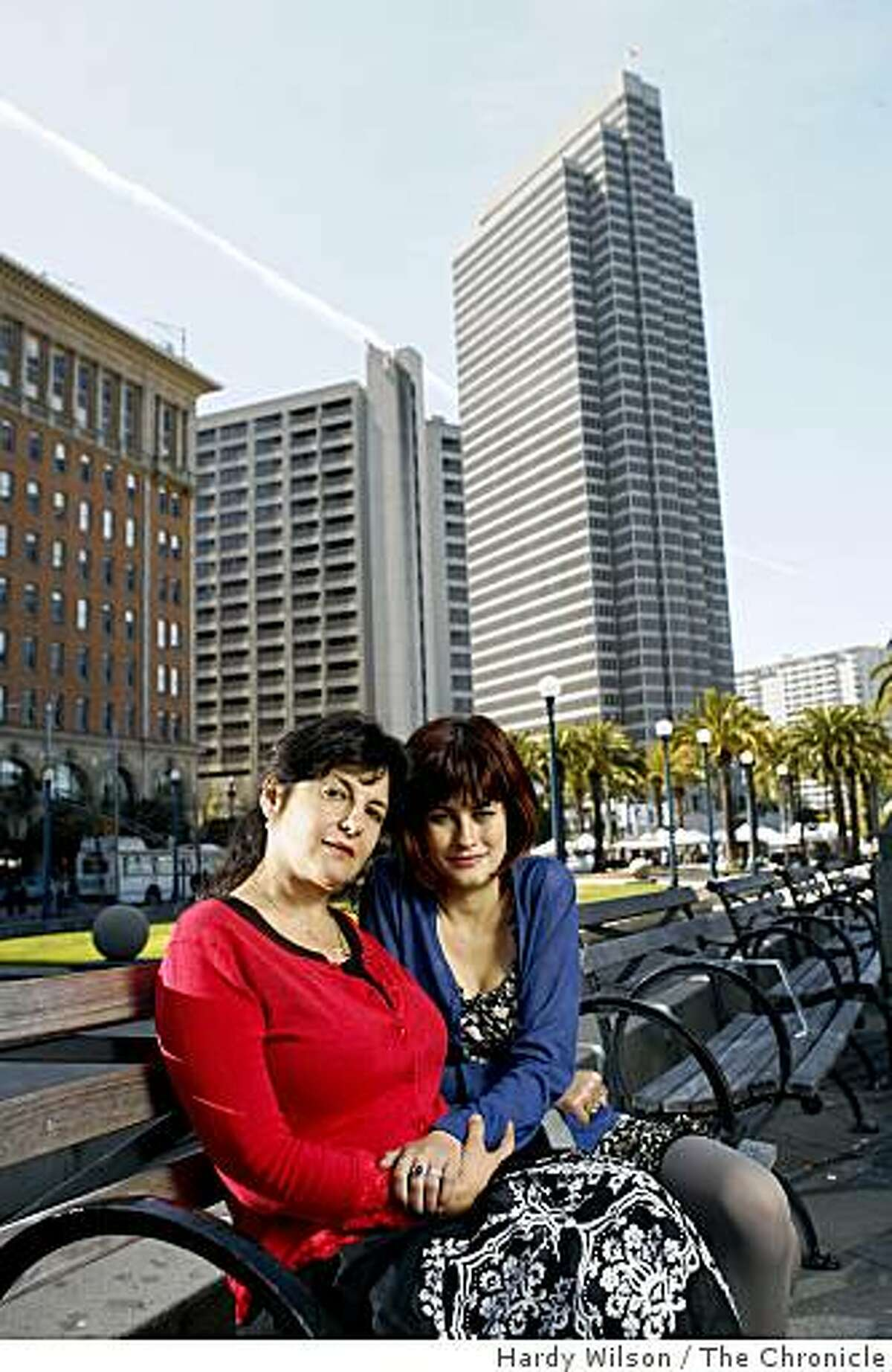 Ericka Lutz and her daughter Anaya Sonnenschein, 16, laugh as they pose for picture near the ferry building in San Francisco, Calif., on Friday, April 17, 2009. An essay Lutz wrote appears in the book, 'Because I Love Her: 34 Women Writers Reflect on the Mother-Daughter Bond'.