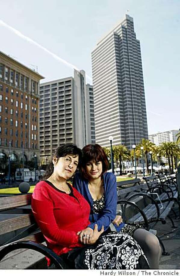 Ericka Lutz and her daughter Anaya Sonnenschein, 16, laugh as they pose for picture near the ferry building in San Francisco, Calif., on Friday, April 17, 2009. An essay Lutz wrote appears in the book, 'Because I Love Her: 34 Women Writers Reflect on the Mother-Daughter Bond'. Photo: Hardy Wilson, The Chronicle