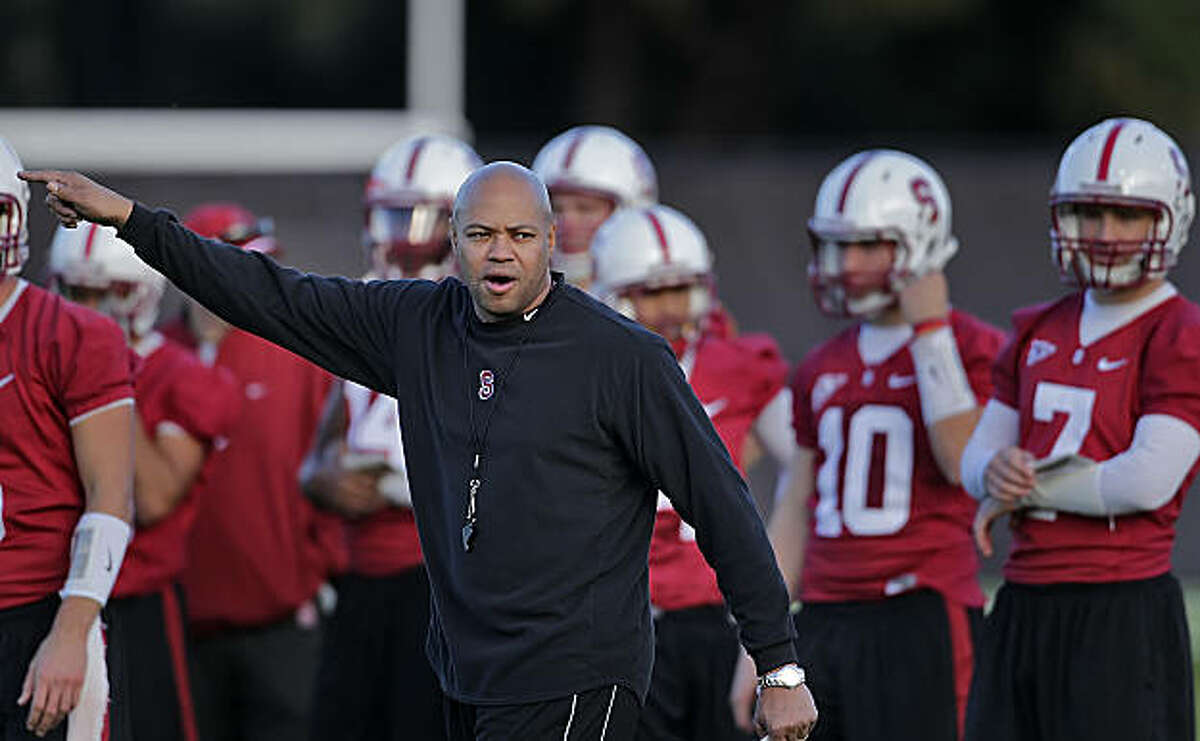 Stanford Cardinals new head coach David Shaw directs his team to the other side of the field during football practice, Monday Feb. 21, 2011, in Stanford, Calif.