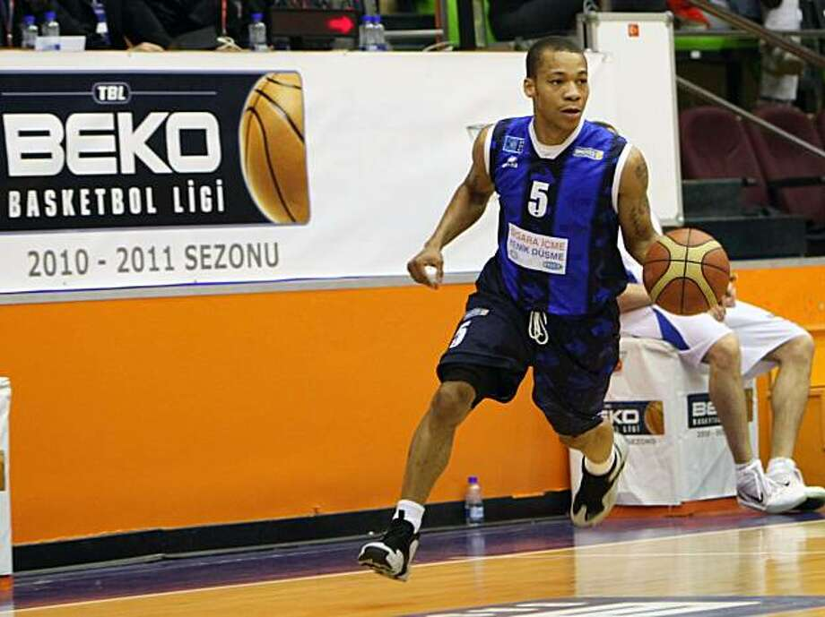 SPECIAL FOR SAN FRANCISCO CHRONICLE - U. S. basketball player Jerome Randle seen during a match of his Turkish club Turk Telekom with Antalya Buyuksehir Belediyesi in Antalya, Turkey, Saturday, Feb. 19, 2011.(AP Photo) Photo: AP