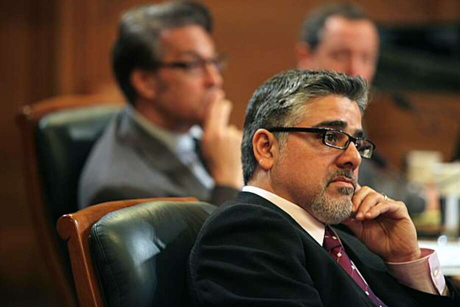 SF supervisors Ross Mirkarimi (behind), John Avalos (front), and Bevan Dufty (far, back) at the Board of Supervisors' Budget Commitee hearing as they listen to concerns at city hall in San Francisco, CA., on Wednesday, March 10, 2010 Photo: Liz Hafalia, The Chronicle