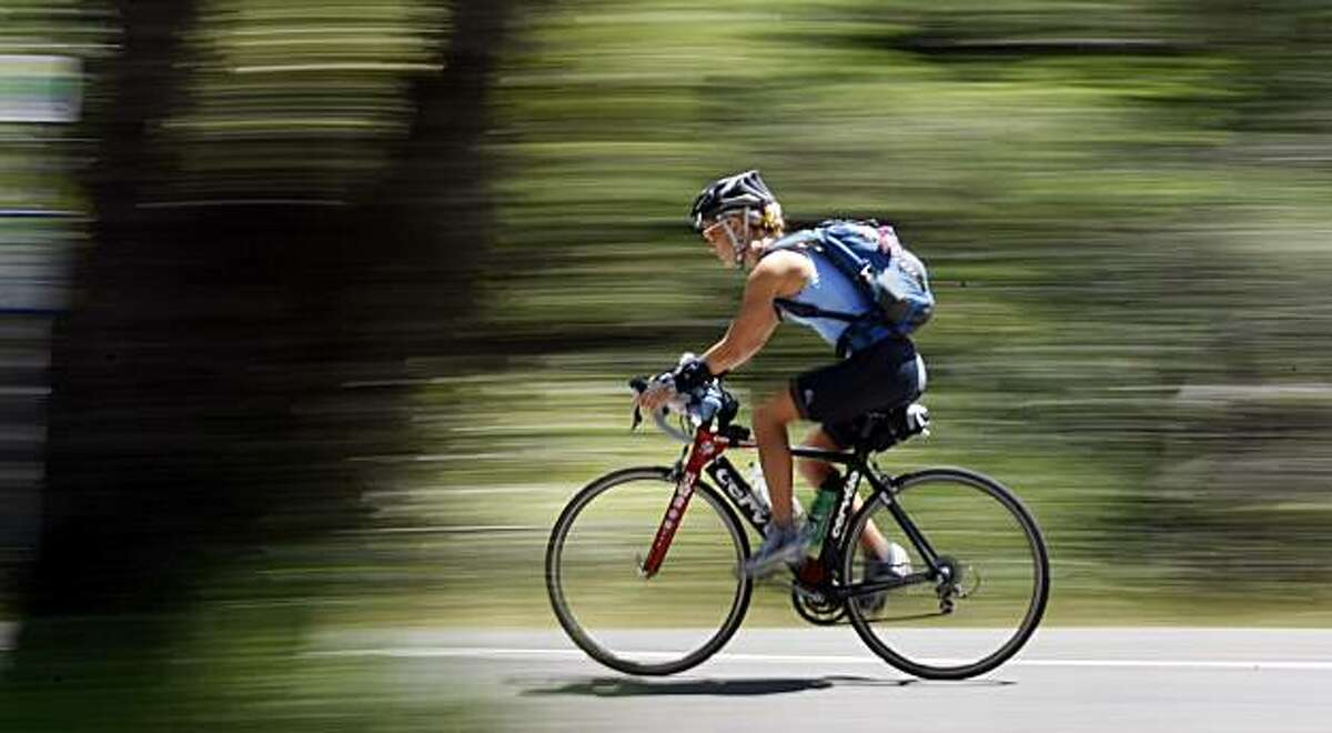 A cyclist makes her way down from the Mount Tamalpais State Park summit Wednesday, May 12, 2010.