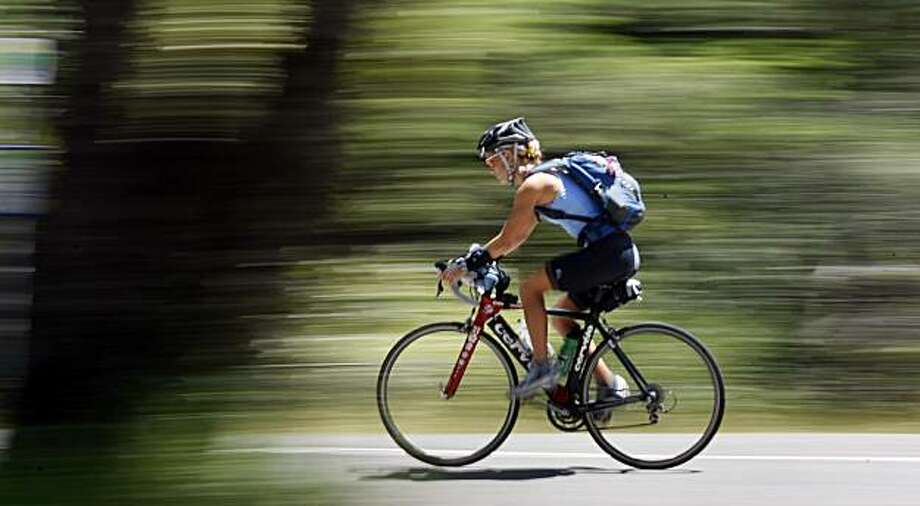 A cyclist makes her way down from the Mount Tamalpais State Park summit Wednesday, May 12, 2010. Photo: Lance Iversen, The Chronicle