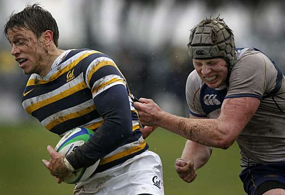 Cal's Blaine Scully (left) tries to escape from a British Columbia Thunderbirds opponent during the Bear's rugby game on Treasure Island in San Francisco, Calif., on Saturday, Feb. 19, 2011. Photo: Paul Chinn, The Chronicle