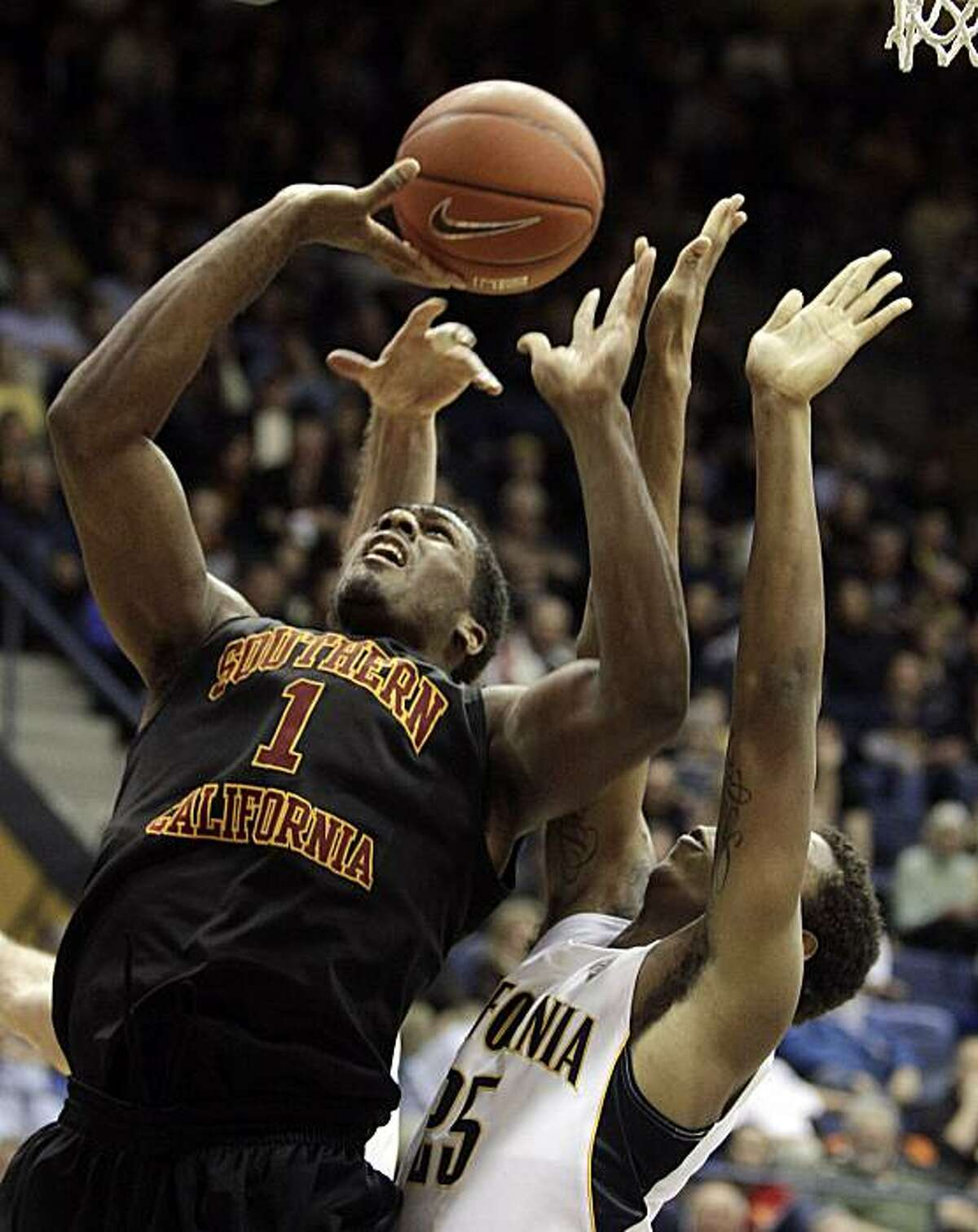 Southern California's Alex Stepheson, left, shoots over California's Richard Solomon (25) during the second half of an NCAA college basketball game Thursday, Feb. 17, 2011, in Berkeley, Calif.