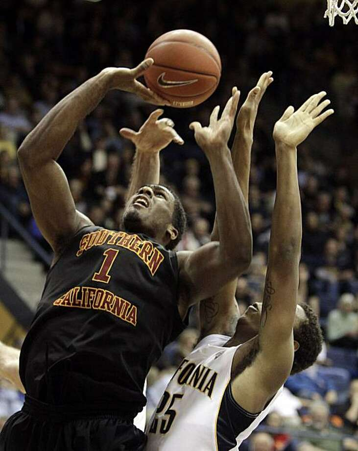 Southern California's Alex Stepheson, left, shoots over California's Richard Solomon (25) during the second half of an NCAA college basketball game Thursday, Feb. 17, 2011, in Berkeley, Calif. Photo: Ben Margot, AP