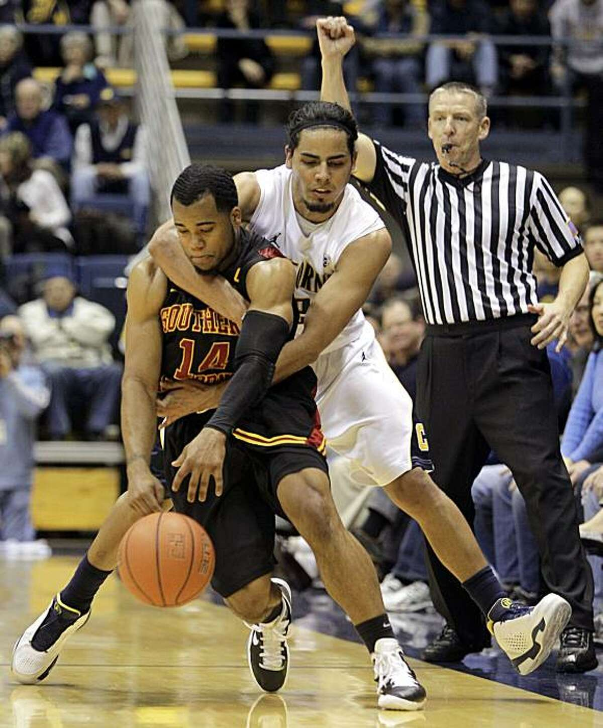 California's Jorge Gutierrez fouls Southern California's Donte Smith during the final seconds of an NCAA college basketball game Thursday, Feb. 17, 2011, in Berkeley, Calif.