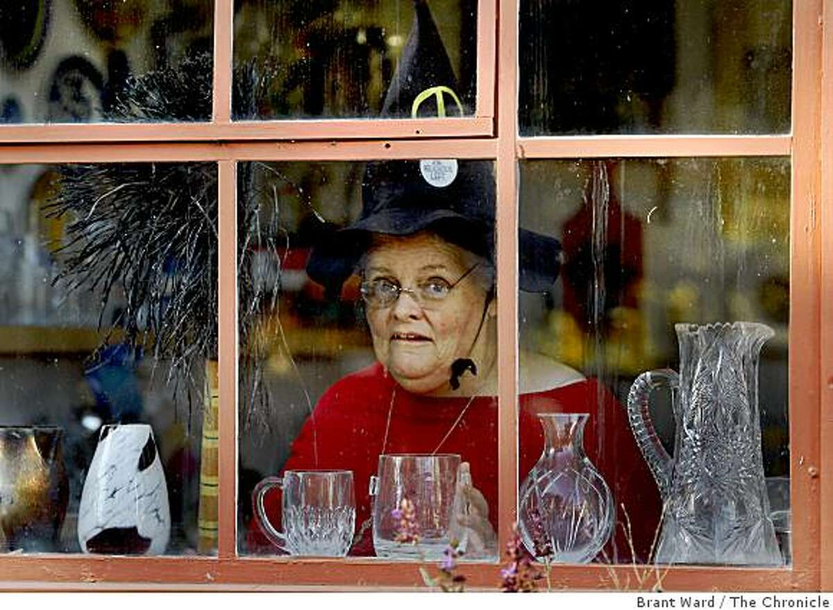 Victoria looks out the window of her home near the Oakland estuary. Victoria Slind-Flor, a veteran witch from Oakland, has been named the Keeper of the Light at this years 8th annual Pagan Festival in Berkeley.