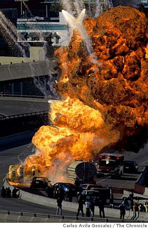 Flames and explosions are seen on the King Street off ramp of northbound 280 in San Francisco, Calif., on Sunday, March 29, 2009, as NBC films a TV pilot called ÒTrauma,Ó about EMTs. A tanker truck and several cars on were destroyed as part of the new drama's story line. Photo: Carlos Avila Gonzalez, The Chronicle