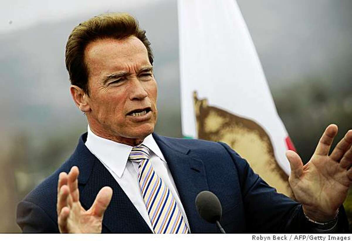 California Governor Arnold Schwarzenegger speaks at a press conference on the swine flu situation on April 27, 2009 in Beverly Hills,CA. US officials confirmed 40 mild cases of deadly swine flu across the United States and warned against non-essential travel to neighboring Mexico. AFP PHOTO Robyn BECK (Photo credit should read ROBYN BECK/AFP/Getty Images)
