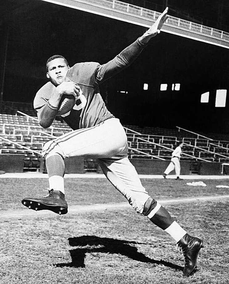 Half back Ollie Matson of Chicago Cardinals shown in posed action in 1954. Photo: Anonymous, AP