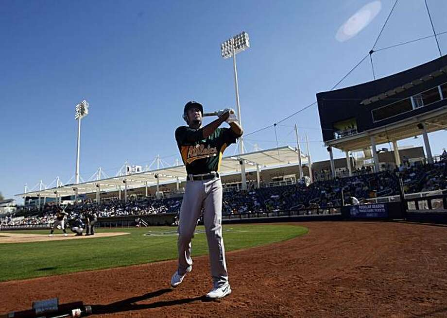 Oakland Athletics Eric Patterson warms up in the batters box during the A's first Spring Training game with the Milwaukee Brewers at Maryvale Baseball Park in Phoenix Arizona Wednesday February 25, 2009 Photo: Lance Iversen, The Chronicle