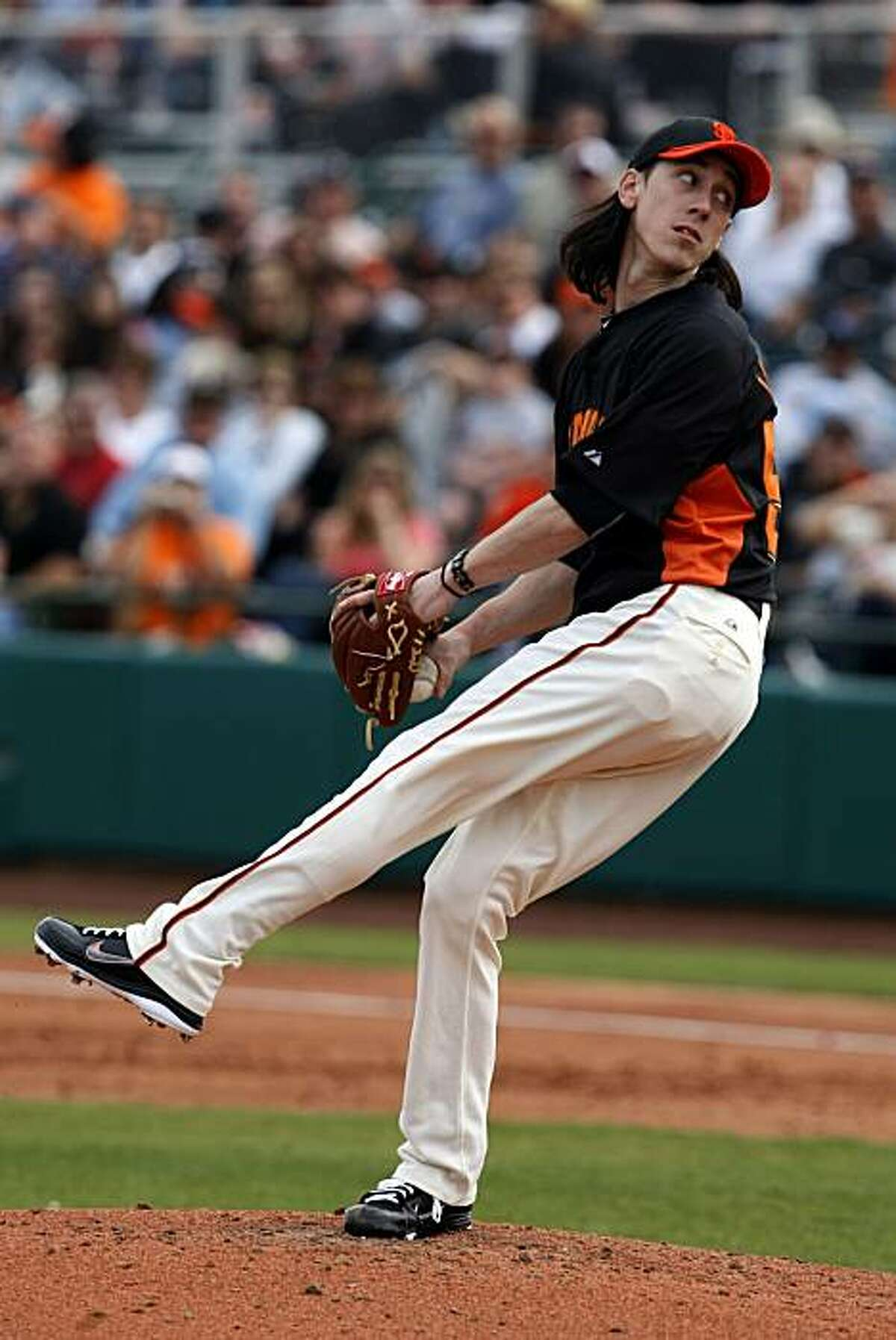San Francisco Giants pitcher Tim Lincecum works against the Arizona Diamondbacks in the second inning of their first spring training game at Scottsdale Stadium on Friday.