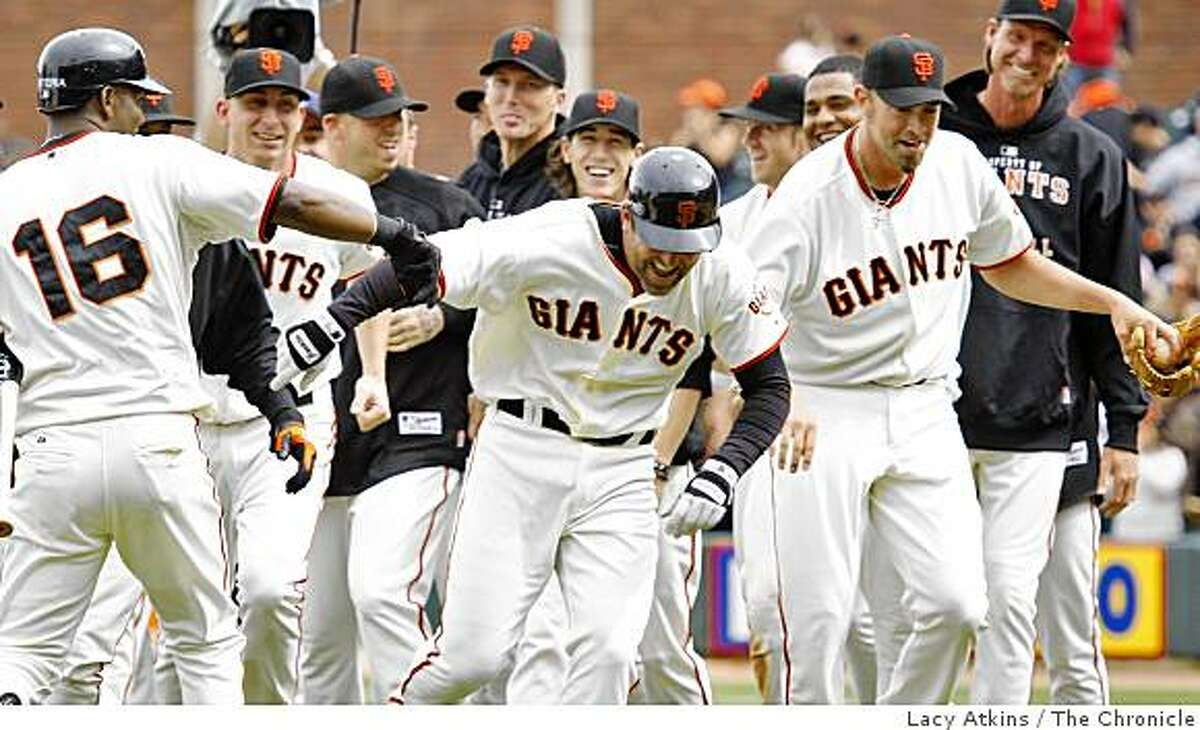 San Francisco Giants Rich Aurilia (center ) breaks loose from his teams hugs after hitting in the only run in the tenth inning against the Colorado Rockies, May 3, 2009, in San Francisco, Calif.