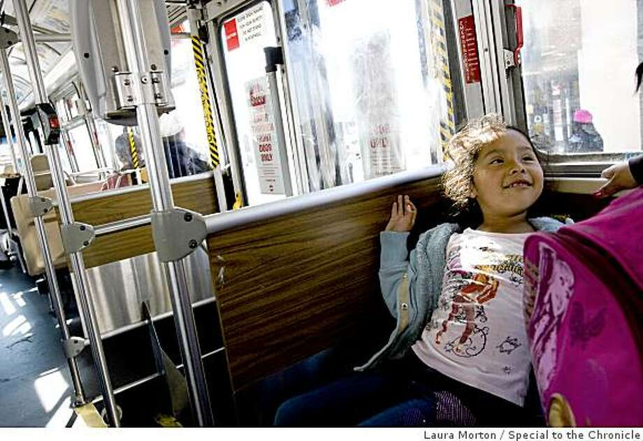 Daniella Garcia, age 6, rides the Muni 26 bus to the Mission in San Francisco, on Friday, April 3, 2009.  The 26 is one of the line's Muni is considering cutting from their service due to budget shortfalls. Photo: Laura Morton, Special To The Chronicle