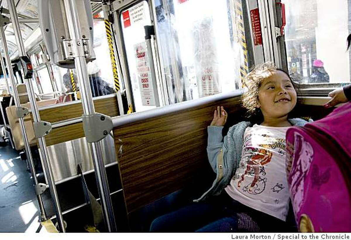 Daniella Garcia, age 6, rides the Muni 26 bus to the Mission in San Francisco, on Friday, April 3, 2009. The 26 is one of the line's Muni is considering cutting from their service due to budget shortfalls.