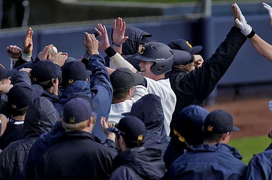 The Golden State Bears cheered as Andrew Knapp was knocked in with a grand slam in the eighth inning against Utah, Sunday Feb. 20, 2011, in Berkeley, Calif. Cal defeated Utah in the first of a double hitter 7-0. Photo: Lacy Atkins, The Chronicle
