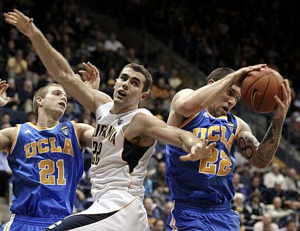 UCLA's Reeves Nelson, right, rebounds past California's Harper Kamp, center, during the first half of an NCAA college basketball game, Sunday, Feb. 20, 2011, in Berkeley, Calif. At left is UCLA's Brendan Lane (21). Photo: Ben Margot, AP
