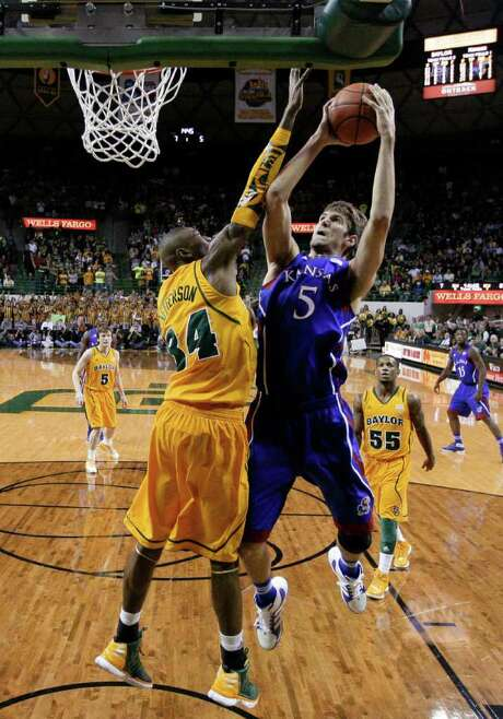 Kansas' Jeff Withey, shooting over Baylor's Cory Jefferson, scored 25 points and combined with Thomas Robinson (15 points, 11 rebounds) to dominate inside. Photo: Tony Gutierrez / AP