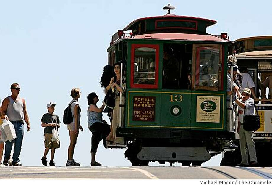 Cable Car riders board at California and Powell Sts. Business section feature about why San Francisco seems to be experiencing a very busy summer tourist season. All the numbers are up from alst year and the last several years. We talk to hoteliers, conventions planners and tourists themselves to find out why. Event in, San Francisco, Ca, on 8/9/06. Photo by: Michael Photo: Michael Macor, The Chronicle