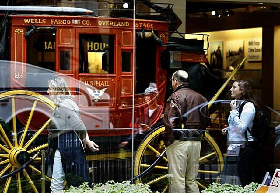 "A Wells Fargo stagecoach that first went into service in the 1860's draws the attention of visitors and those passing by the Wells Fargo Historical Museum on Montgomery Street Monday May 5, 2009. Regulators may ask Wells Fargo Bank, which is headquartered in San Francisco, CA to improve its' capital reserves because of recent findings with the banking ""stress tests."" Photo: Brant Ward, The Chronicle"