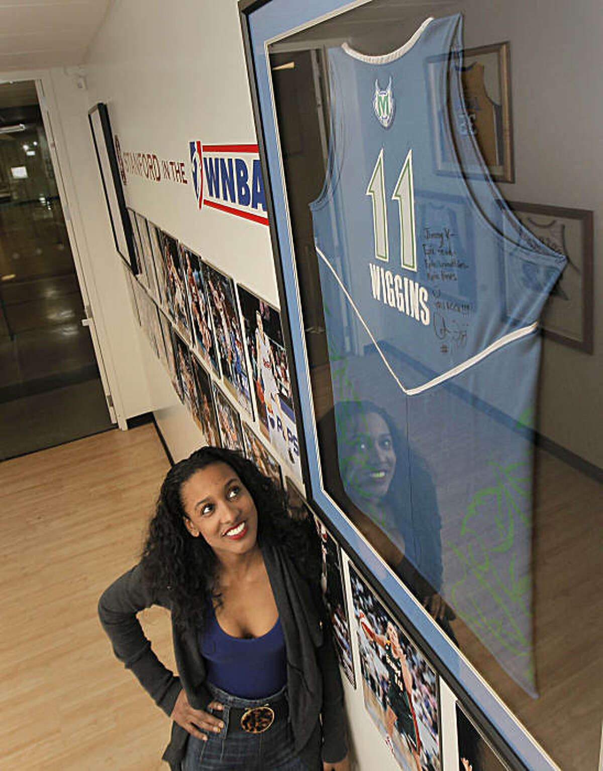 Former Stanford University basketball player, Candice Wiggins, on Wednesday Dec. 8, 2010, in Palo Alto, Calif., has her WNBA jersey hanging on the walls of the family sports center on campus. Wiggins is back at school taking undergraduate studies outside of her professional basketball career with the Minnesota Lynx.
