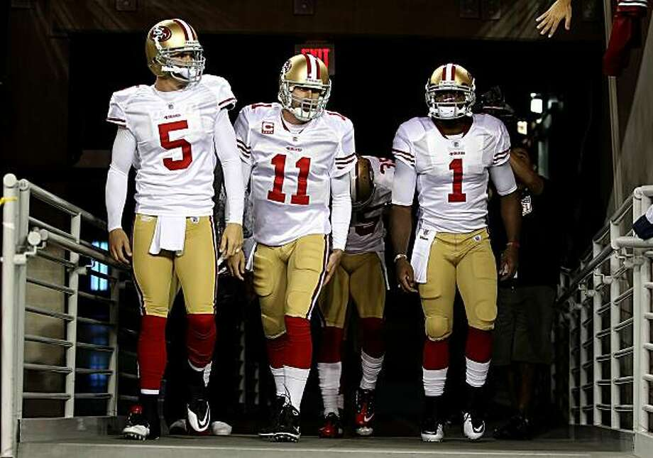 Quarterbacks David Carr (5), Alex Smith (11) and Troy Smith (1) of the San Francisco 49ers walk out onto the field before the NFL game against the Arizona Cardinals at the University of Phoenix Stadium on November 29, 2010 in Glendale, Arizona. Photo: Christian Petersen, Getty Images