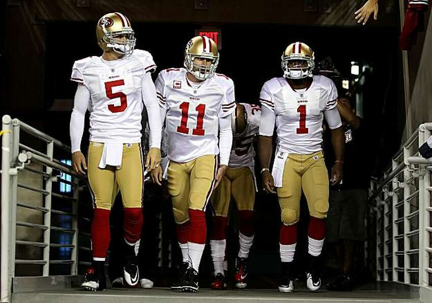 Quarterbacks David Carr (5), Alex Smith (11) and Troy Smith (1) of the San Francisco 49ers walk ou