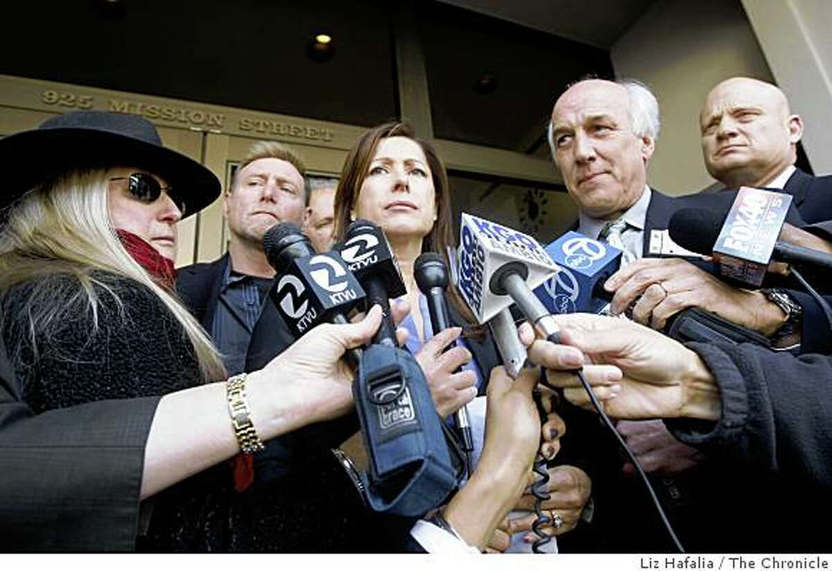 Deborah Perez (center) says she was the daughter of the Zodiac, with spokeman Kevin McLean (right), a former partner of the late S.F. attorney Melvin Belli having a press conference in front of the Chronicle building in San Francisco, Calif., on Wednesday, April 29, 2009.