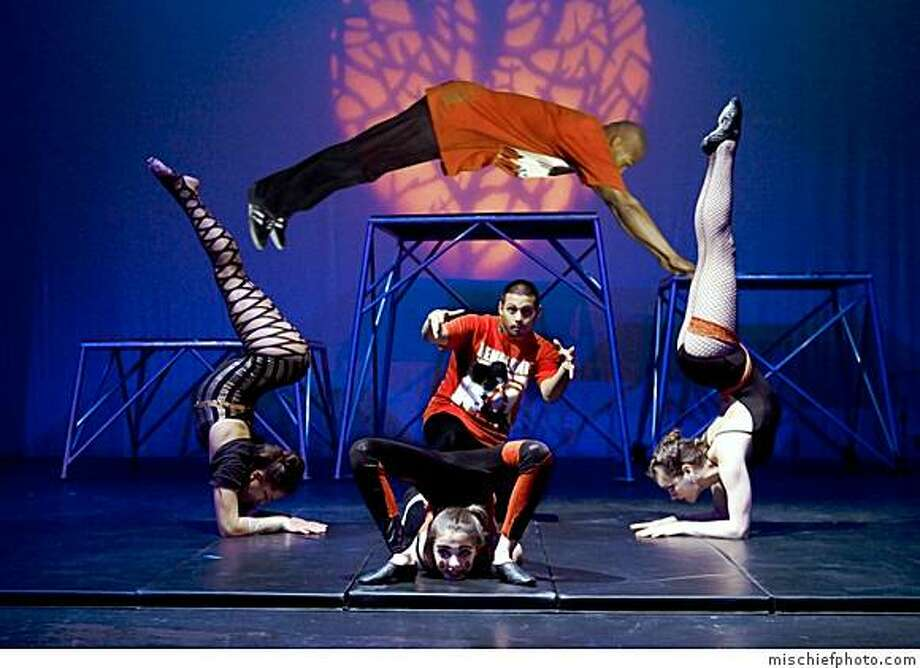 "Shawn Hallman aka Iron Monkey dives between Chloe Axelrod (left) and Nancy Kate Siefker (right), above contortionist Allton Vogel-Denebeim and beat-boxer Bobby Vicario aka Finesse in City Circus' ""Kamikaze Heart"" at Brava Theater. Photo: Mischiefphoto.com"