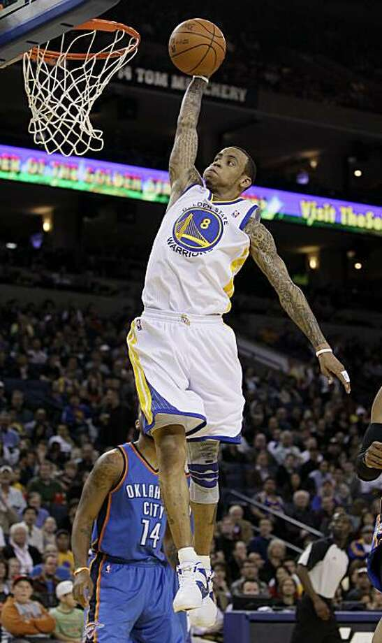 Golden State Warriors shooting guard Monta Ellis (8) dunks against the Oklahoma City Thunder in the second quarter of an NBA basketball game in Oakland, Calif., Sunday, Feb. 13, 2011. Photo: Jeff Chiu, AP