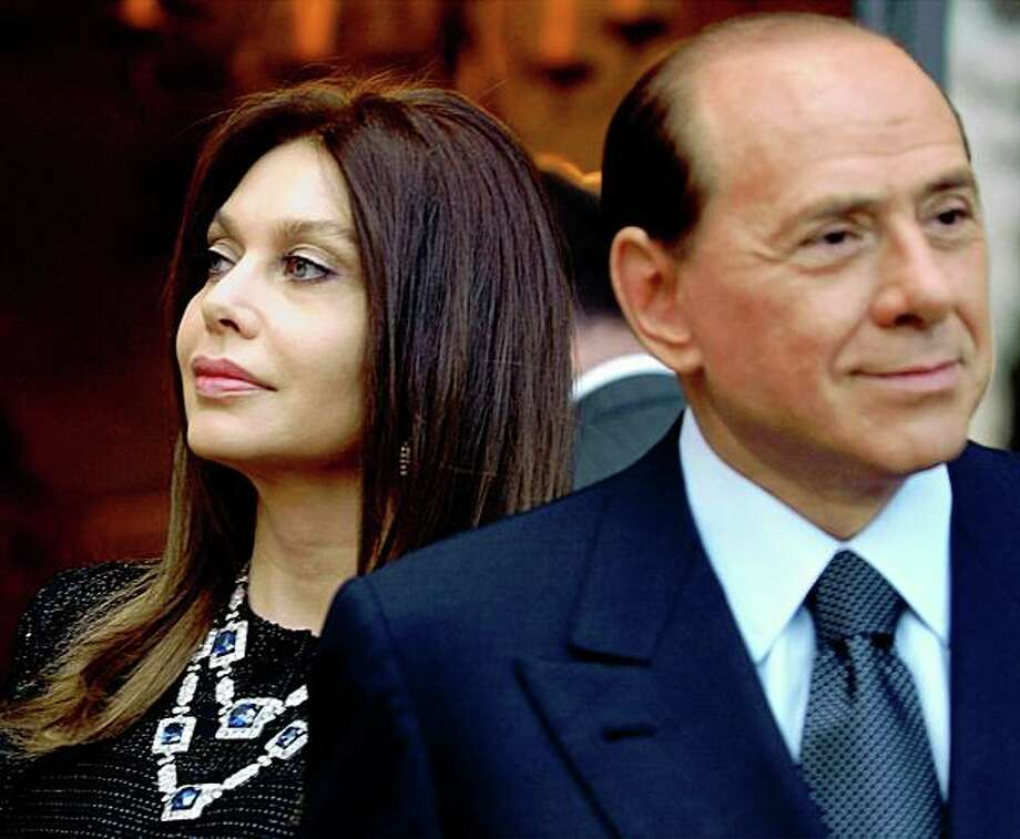FILE -  In this Friday June 24, 2004 file photo, Italian premier Silvio Berlusconi, right, and his wife Veronica Lario wait for President George W. Bush and first lady Laura Bush at the Villa Madama residence for a social dinner, in Rome. On Sunday, May 3, 2009 two Italian newspapers reported that Premier Silvio Berlusconi's wife is seeking a divorce. La Stampa and La Repubblica dailies say Veronica Lario had retained a divorce attorney to begin the process of legal separation and divorce. Berlusconi's office said it had no comment Sunday.    (AP Photo/Susan Walsh, File) Photo: Susan Walsh, File, AP