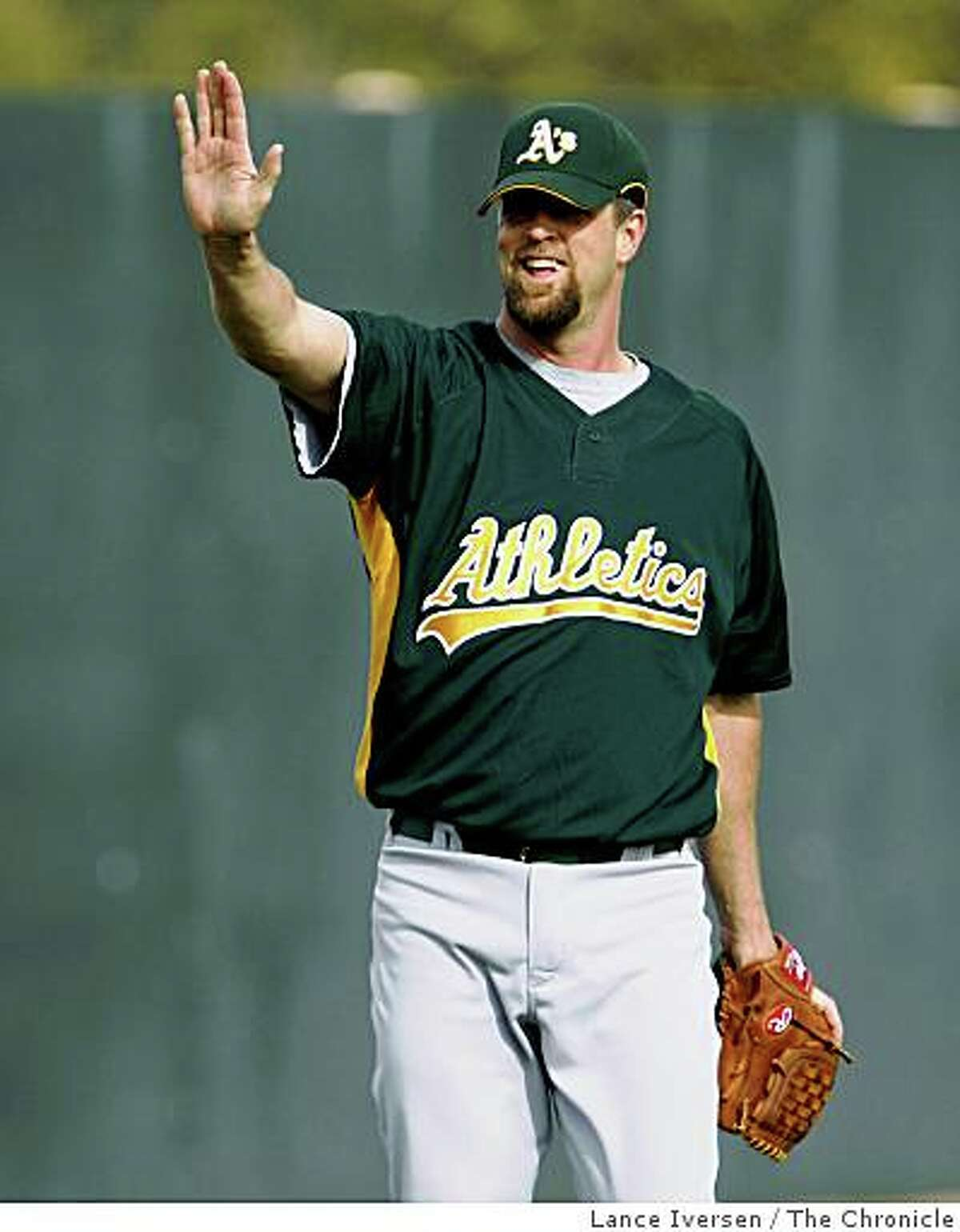 Oakland Athletics pitcher Russ Springer jokes with teammates during Spring Training workouts at the Papago Baseball Facility Monday February 16, 2009 in Phoenix Arizona