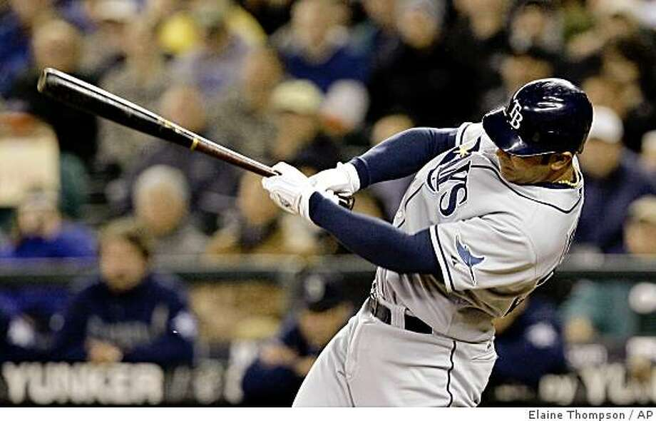 Tampa Bay Rays' Carlos Pena hits a two-run double against the Seattle Mariners in the first inning of a baseball game Wednesday, April 22, 2009, in Seattle. (AP Photo/Elaine Thompson) Photo: Elaine Thompson, AP