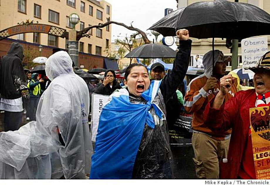 On May Day, Diane Ventura, of Oakland, joins hundreds of others who  march from Fruitvale BART Station to downtown Oakland during a rally and March in support of immigrant rights on Friday May 1, 2009 in Oakland, Calif. Photo: Mike Kepka, The Chronicle