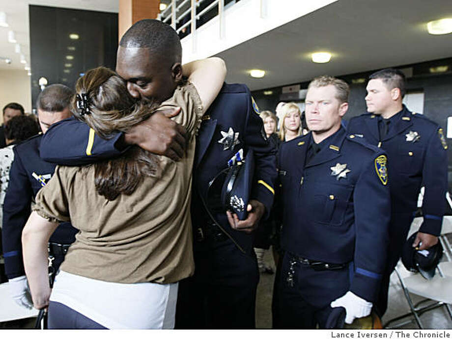 Oakland police officer Sgt. Sekou Millington hugs Jennifer Sakai, widow of slain Sgt. Daniel Sakai, at the department's annual memorial ceremony honoring the lives of officers killed in the line of duty on Wednesday, May 5, 2009 in Oakland, Calif. Photo: Lance Iversen, The Chronicle