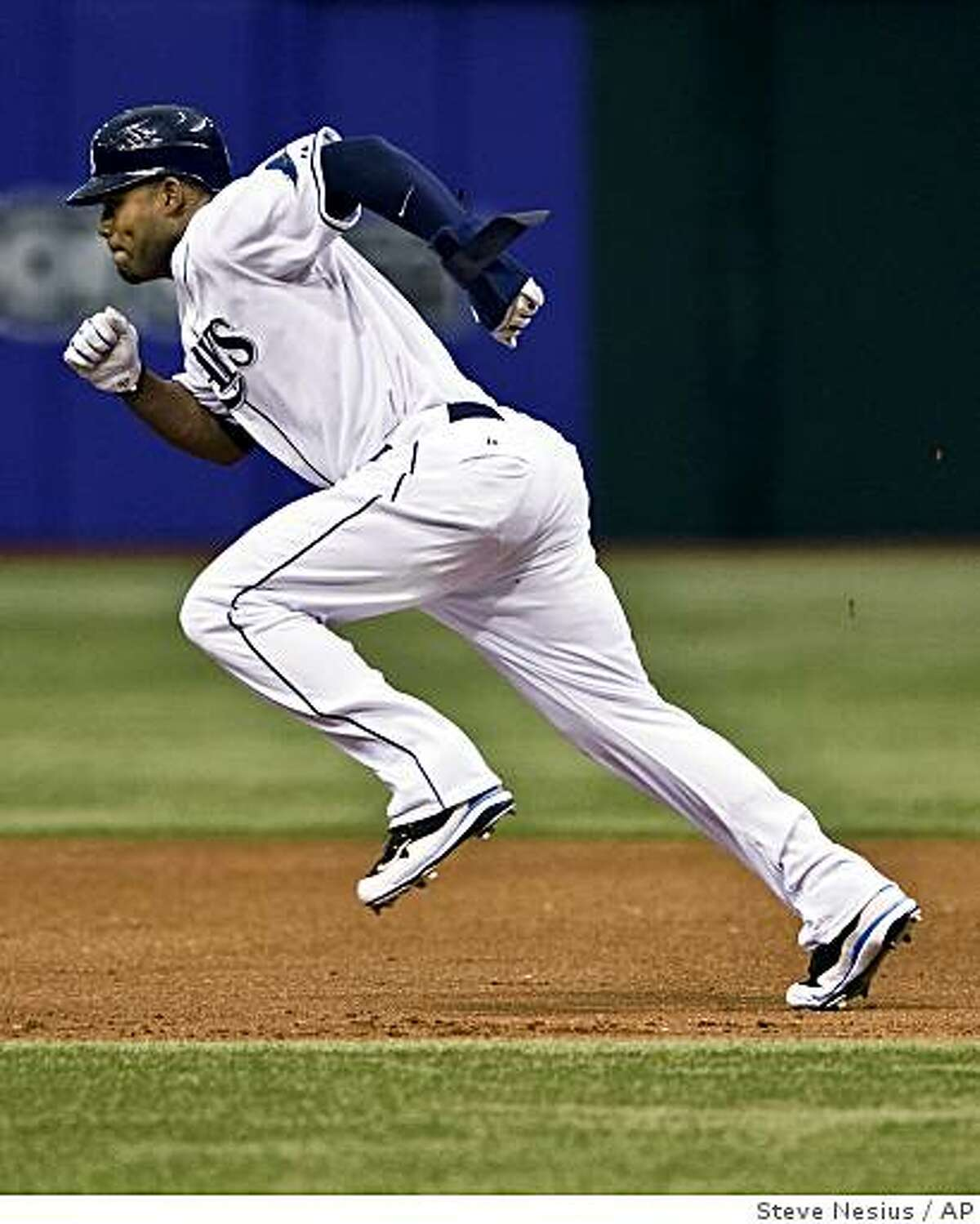 Tampa Bay Rays' Carl Crawford races toward second as he steals a base during the first inning of a game against the Baltimore Orioles on Tuesday, May 5, 2009, in St. Petersburg, Fla.