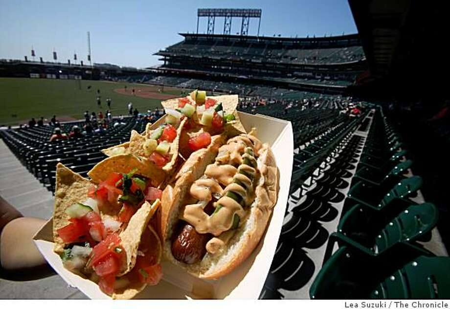Tres Agaves serves a bacon-wrapped hot dog at AT&T Park on Wednesday April 22,  2009 in San Francisco, Calif. Photo: Lea Suzuki, The Chronicle