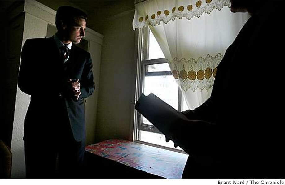 File photographs from 2004. Mayor Newsom (left) looks out the window of a room at the McAllister Hotel that will soon house a homeless person, part of his Care Not Cash program. Mayor Newsom begins his Care Not Cash program with a tour of the McAllister Hotel and the Tenderloin homeless situation. Photo: Brant Ward, The Chronicle