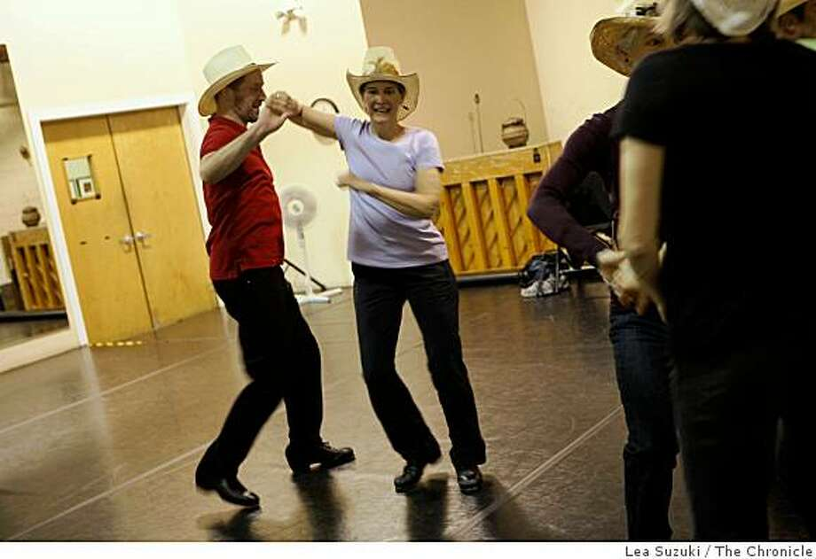 Rick Sherwin of San Francisco (l to r) and Carolyn Jayne rehearse with the Golden Gate Clogging Company at City Dance Studio in San Francisco, Calif. on Monday April 6, 2009. Photo: Lea Suzuki, The Chronicle