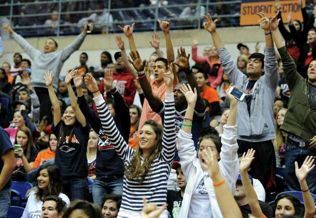 Fans sitting in the UTSA student section cheer on the Roadrunners during a Southland Conference mens  basketball game between UTSA and Southeastern Louisiana at the UTSA Convocation Center In San Antonio, Texas on February 8, 2012. John Albright / Special to the Express-News. Photo: Express-News